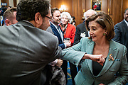 "House Speaker Nancy Pelosi (D-CA) bumps elbows with an attendee of a news conference marking the one year anniversary of tahe passing of H.R.1, the ""For The People Act"" on Tuesday, March 10, 2020.  The elbow bump is due to the coronavirus outbreak. (photo by Pete Marovich for The New York Times)"