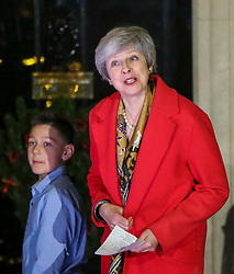 © Licensed to London News Pictures. 19/11/2018. London, UK. British Prime Minister Theresa May switches on the Christmas tree lights outside Number 10 Downing Street.  A traditional Military wives choirs sings carols to mark the Christmas tree lights switch on. Photo credit: Dinendra Haria/LNP