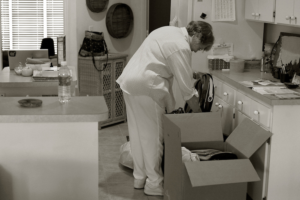 Bobbie Campbell packs up her late husbands clothing and sorts through finical paperwork following his death from pancreatic cancer, Jan 16.