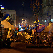 December 18, 2013 - Kiev, Ukraine: Pro-EU demonstrators sit beside a barricade on a road leading to Independence Square, where thousands have been gathering in the past four weeks. (Paulo Nunes dos Santos/Polaris)