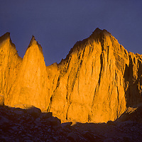 Mount Whitney glows during  a brief, stormy sunrise in California's Sierra Nevada.