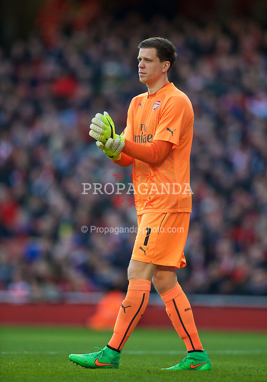LONDON, ENGLAND - Sunday, February 15, 2015: Arsenal's goalkeeper Wojciech Szczesny wearing a bright fluorescent orange kit during the FA Cup 5th Round match against Middlesbrough at the Emirates Stadium. (Pic by David Rawcliffe/Propaganda)