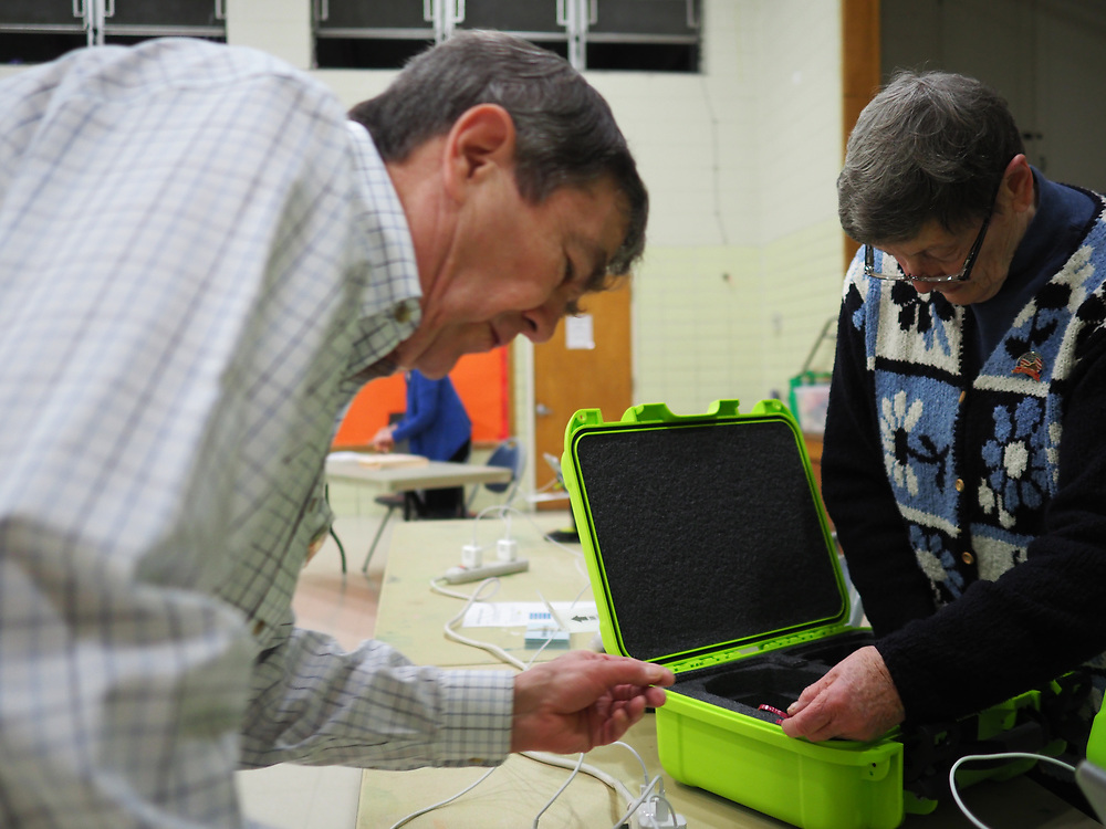 Arlington, VA election officials prepare to open the polls on Presidential Primary Day.
