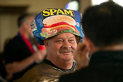"""Paul Steele, the """"Spam King,"""" prepares for an on-camera interview at the 22nd annual Spam Festival, Sunday, Feb. 16, 2019, in Isleton, Calif. Spam lovers competed for prizes by presenting their favorite Spam-infused foods, or entering the Spam-eating and Spam-toss contests. (Photo by D. Ross Cameron)"""