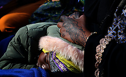 SOUTH AFRICA - Cape Town - 25 May 2020 - Refugee Muslim girl sleeping on her mothers lap during prayers as they celebrate Eid. The refugee community in Bellville has Muslims from various different African countries celebrate Eid together. Eid marks the end of a month of fasting from sunrise to sunset as well as spiritual reflection and prayer.  Picture:Brendan Magaar/African News Agency (ANA)
