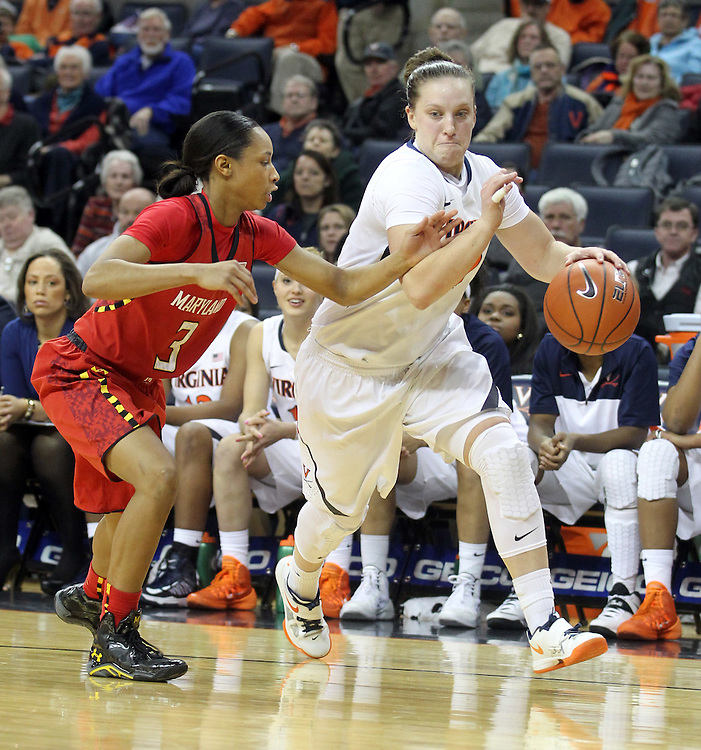 Virginia guard Kelsey Wolfe (10) drives past Maryland guard Brene Moseley (3) during the game Thursday in Charlottesville, VA. Virginia defeated Maryland 86-72. Photo/The Daily Progress/Andrew Shurtleff