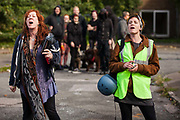 Housing activists jeer at bailiffs at the Sweets Way housing estate on 23rd September 2015 in London, United Kingdom. A group of housing activists calling for better social housing provision in London had occupied properties on the 142-home estate in Whetstone, in a few cases refurbishing properties intentionally destroyed by the legal owners following eviction of the original residents, in order to try to prevent the eviction of the estate's last remaining resident and the planned demolition and redevelopment of the entire estate by Barnet Council and Annington Property Ltd.
