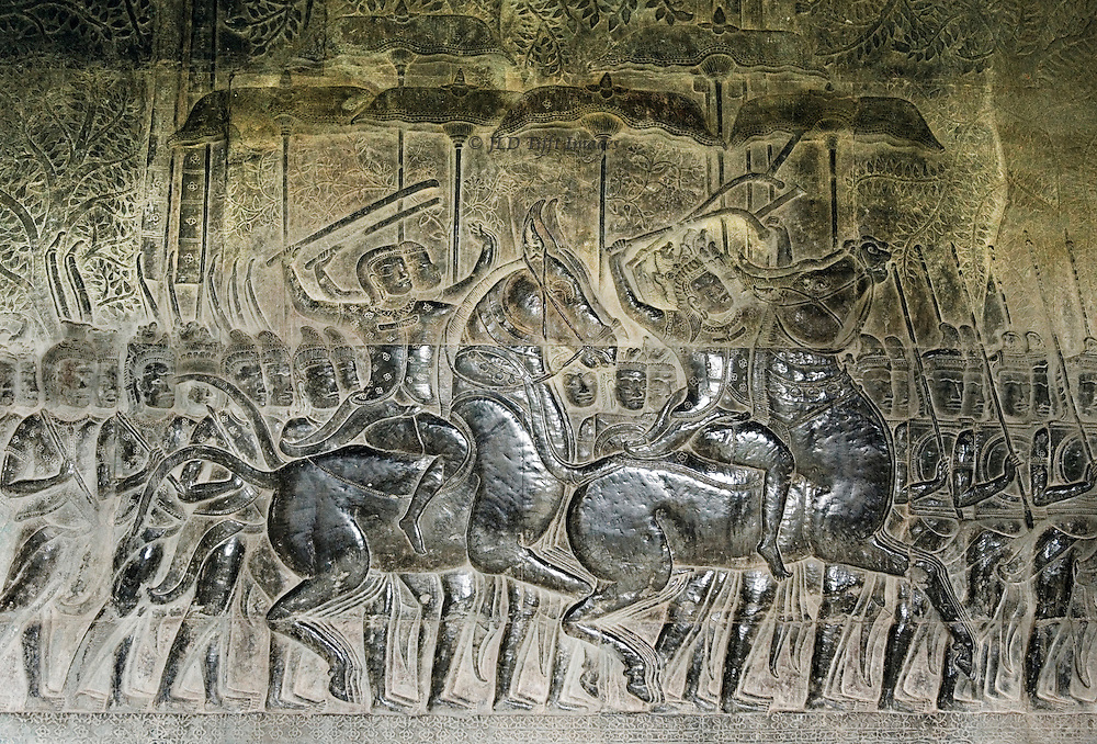 Angkor Wat : carved wall reliefs showing the Kurukshetra War described in the Mahabharata; detail of two commanders on horseback, two more just behind them.  Extremely fine low relief sculpture.
