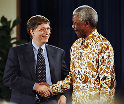 Microsoft CEO BILL GATES, left, with NELSON MANDELA Dec. 9, 1999 in Seattle. (Credit Image: © Barry Sweet/ZUMApress.com)