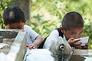 Children drinking from a fountain at the primary school in the town of Coyolito, Honduras on Wednesday April 24, 2013.