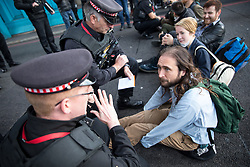 © Licensed to London News Pictures. 30/10/2017. London, UK. Seven demonstrators blocked Tower Bridge today, protesting against pollution caused by fuel emmission levels, and were subsequently arrested. Photo credit : Tom Nicholson/LNP