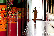 A Buddhist monk walks down the colorful halls of a monastery in Soc Trang Province. Robert Dodge, a Washington DC photographer and writer, has been working on his Vietnam 40 Years Later project since 2005. The project has taken him throughout Vietnam, including Hanoi, Ho Chi Minh City (Saigon), Nha Trang, Mue Nie, Phan Thiet, the Mekong, Sapa, Ninh Binh and the Perfume Pagoda. His images capture scenes and people from women in conical hats planting rice along the Red River in the north to men and women working in the floating markets on the Mekong River and its tributaries. Robert's project also captures the traditions of ancient Asia in the rural markets, Buddhist Monasteries and the celebrations around Tet, the Lunar New Year. Also to be found are images of the emerging modern Vietnam, such as young people eating and drinking and embracing the fashions and music of the West. His book. Vietnam 40 Years Later, was published March 2014 by Damiani Editore of Italy.