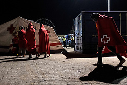 June 21, 2017 - Malaga, Spain - 52 migrants among them one woman and two under-aged boys were rescued by the Spanish Maritime. Late at night, on the 21st of June 2017, the Spanish maritime boat arrived at the Malaga harbour, where the migrants welcomed by the Red cross. (Credit Image: © Guillaume Pinon/NurPhoto via ZUMA Press)