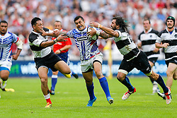 Samoa Fly-Half Tusi Pisi is tackled by Barbarians replacement Jacques Potgieter (Ms Blues & South Africa) - Mandatory byline: Rogan Thomson/JMP - 07966 386802 - 29/08/2015 - RUGBY UNION - The Stadium at Queen Elizabeth Olympic Park - London, England - Barbarians v Samoa - International Friendly.