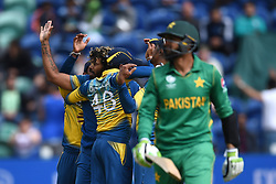 Sri Lanka's Lasith Malinga celebrates taking the wicket of Pakistan's Shoaib Malik during the ICC Champions Trophy, Group B match at Cardiff Wales Stadium. PRESS ASSOCIATION Photo. Picture date: Monday June 12, 2017. See PA story CRICKET Sri Lanka. Photo credit should read: Joe Giddens/PA Wire. RESTRICTIONS: Editorial use only. No commercial use without prior written consent of the ECB. Still image use only. No moving images to emulate broadcast. No removing or obscuring of sponsor logos.
