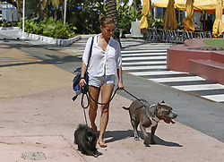 Stephani Nguyen of Miami walks her dog Dior, left, and Ace, right, at Lincoln Road in the Hurricane Irma aftermath on Tuesday, September 12, 2017, in Miami Beach. Photo by David Santiago/El Nuevo Herald/TNS/ABACAPRESS.COM
