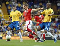 Photo: Ed Godden.<br /> Brazil v Wales. International Friendly. 05/09/2006.<br /> Wales's Sam Rickett (Centre) gets away from Brazil's Maicon (R).