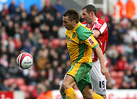 Photo: Paul Greenwood/Sportsbeat Images.<br />Stoke City v Norwich City. Coca Cola Championship. 01/12/2007.<br />Nrwich's Darren Huckerby, (L) holds off the challenge of Stephen Wright to score