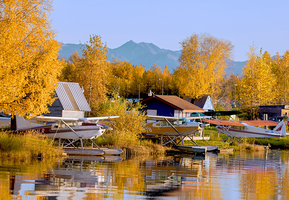 Alaska; Autumn scenic of float planes parked on Lake Hood, Anchorage.