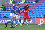 Nottingham Forest's Alex Mighten (17) under pressure from Cardiff City's Aden Flint (5) during the EFL Sky Bet Championship match between Cardiff City and Nottingham Forest at the Cardiff City Stadium, Cardiff, Wales on 2 April 2021.