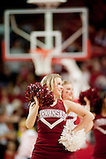 Nov 16, 2011; Fayetteville, AR, USA;  An Arkansas Razorbacks cheerleader performs during a game against the Oakland Grizzlies at Bud Walton Arena. Arkansas defeated Oakland 91-68. Mandatory Credit: Beth Hall-US PRESSWIRE