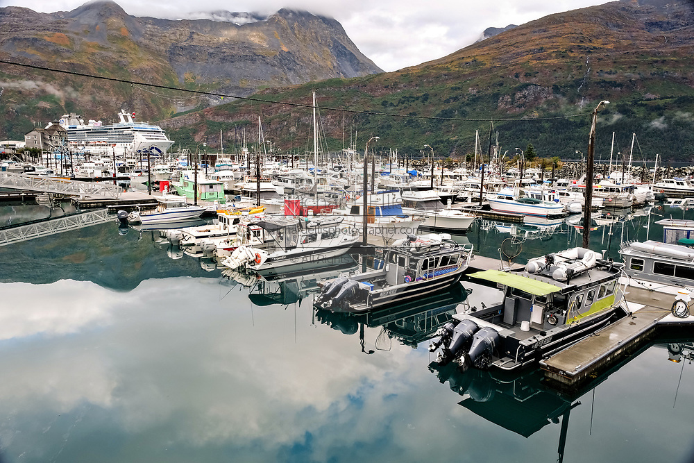 Fishing boats docked the Whittier marina and Cruise Ship terminal on the Passage Canal in Prince William Sound, Whittier, Alaska.
