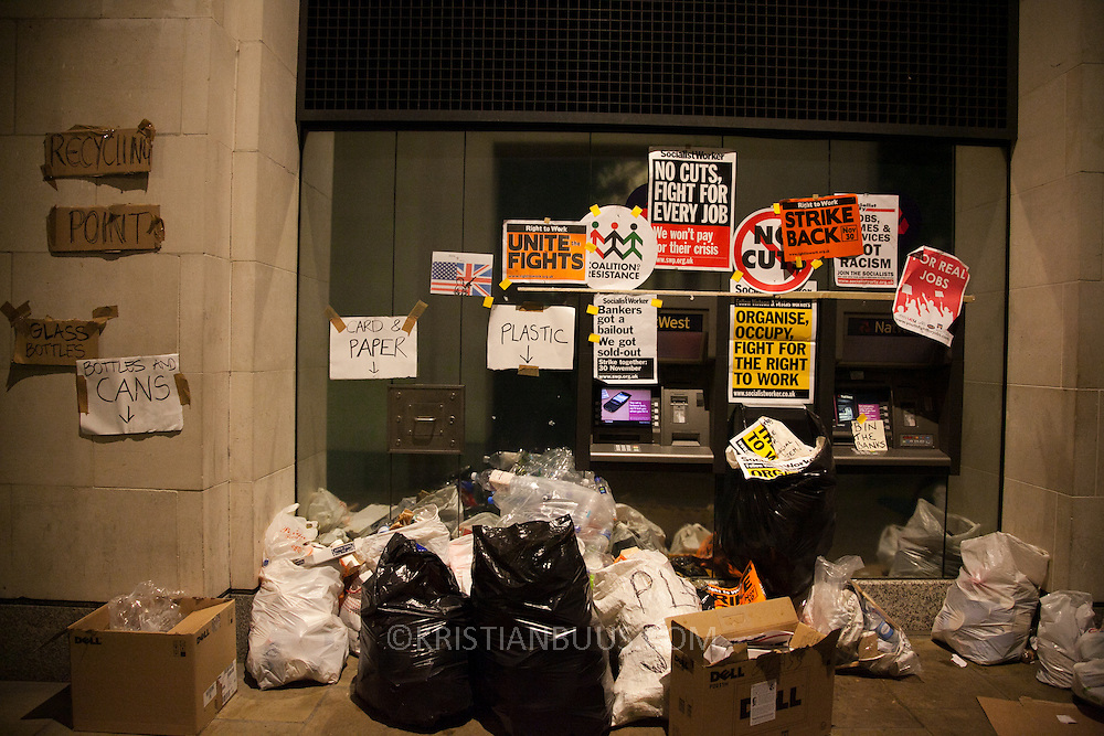 Rubbish collected by cash machines. The London Stock Exchange was attempted occypied in solidarity with Occupy Wall in Street in New York and in protest againts the economic climate, blamed by many on the banks. Police managed to keep people away fro the Patornoster Sqaure and the Stcok Exchange and thousands of protestors stayid in St. Paul's Square, outside St Paul's Cathedral. Many camped getting ready to spend the night in the square.