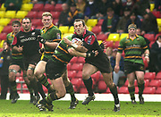 Watford, GREAT BRITAIN, 15th Feburary 2004, Vicarage Road, ENGLAND. [Mandatory Credit: Photo  Peter Spurrier/Intersport Images],<br /> 15/02/2004  -  Zurich Premiership, Saracens v Northampton Saints<br /> Thomas Castaignede with the ball is tackled by Saints Mark Tucker.