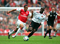Photo: Tom Dulat.<br /> Arsenal v Sunderland. The FA Barclays Premiership. 07/10/2007.<br /> Dwight Yorke of Sunderland and Theo Walcott of Arsenal with the ball