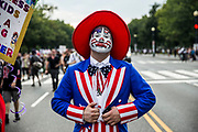 WASHINGTON, USA - September 16: A Juggalo in costume marches during the Juggalo March in Washington, USA on September 16, 2017. Juggalo's are fans and followers of the rap group Insane Clown Posse and they are protesting the FBI's 2011 classification of Juggalo's as a Street Gang.