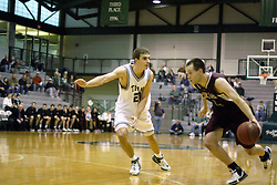 16 December 2006: Brandon Woodhead works to get past Andrew Freeman. The University of Chicago Maroons upset  the Illinois Wesleyan Titans 64 - 60 at the Shirk Center in Bloomington Illinois.<br />