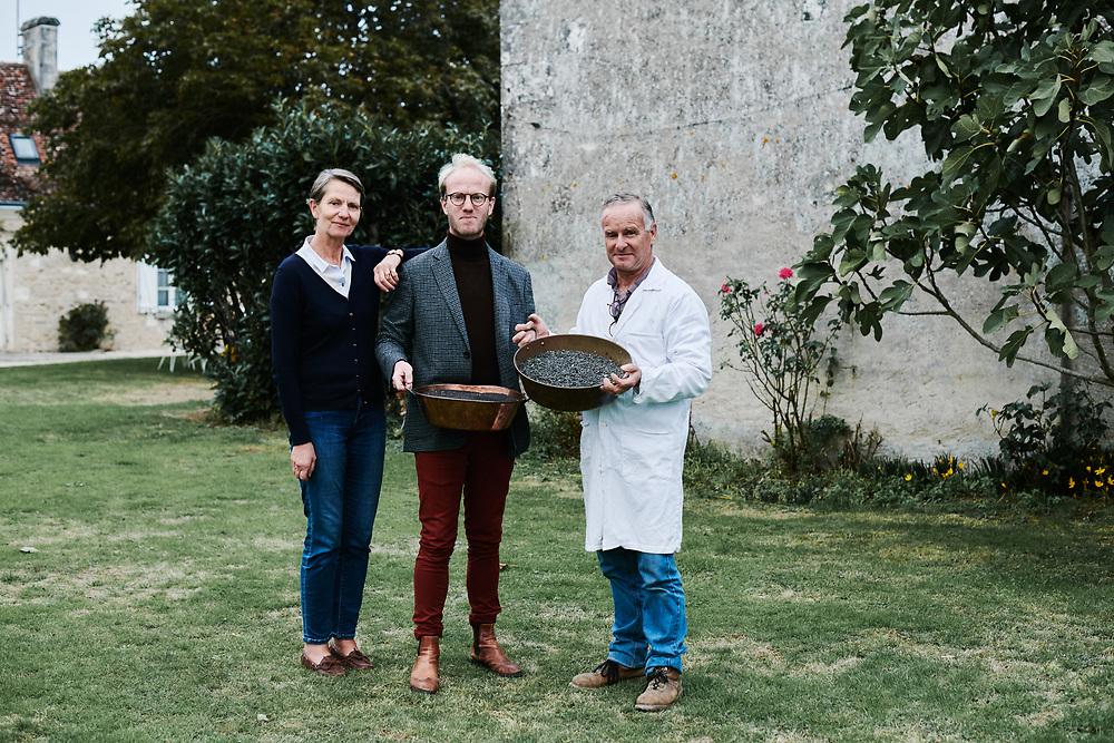 Xavier Desforges, surrounded by his parents outside Maison Caulieres' farm. Dolus-le-Sec, France. October 7, 2019.