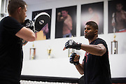 UFC heavyweight Alistair Overeem of The Netherlands hits mitts with striking coach Brandon Gibson at Jackson Wink MMA in Albuquerque, New Mexico on June 9, 2016.
