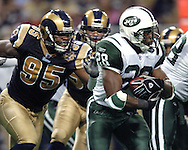 New York Jets running back Curtis Martin (28) rushes to the outside past St. Louis Rams defensive end Anthony Hargrove (95), during the first half of the Rams 32-29 overtime win in St. Louis, Missouri, January 2, 2005.