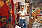 Vietnamese artist Huong poses in her downtown gallery in Jensen Beach November 12, 2007.(Photo by Steve Mitchell)