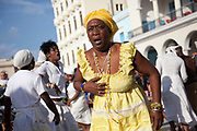 Cuban woman of African descent dancing, looking surprised and angry as part of a performance. Performance in Havana old town, local dance and theatre group enacting the slave trade, colonial rule and how African religion and beliefs continuing, becoming what is now Santeria.