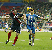 Photo: Aidan Ellis.<br /> Wigan Athletic v West Bromwich Albion. The Barclays Premiership. 15/01/2006.<br /> Wigan's Arjun De Zeuw and West Brom's Ronnie Wallwork