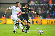 ( L-R ) Jordan Ayew of Swansea City and Shinji Okazaki of Leicester City in action. Premier league match, Swansea city v Leicester city at the Liberty Stadium in Swansea, South Wales on Saturday 21st October 2017.<br /> pic by Aled Llywelyn, Andrew Orchard sports photography.