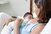 Goiania_GO, Brasil.<br /> <br /> Mae amamentando o filho.<br /> <br /> Mother breastfeeding her child.<br /> <br /> Foto: NIDIN SANCHES / NITRO