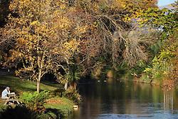 May 4, 2019 - Christchurch, New Zealand - A boy eats a snack as he enjoys the lake sight during autumn season at North Hagley Park in Christchurch, New Zealand on May 03, 2019. (Credit Image: © Sanka Vidanagama/NurPhoto via ZUMA Press)