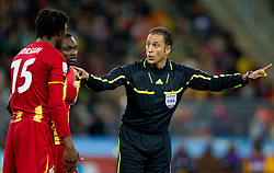 Isaac Vorsah of Ghana and referee Olegario Benquerenca (POR)  during to the 2010 FIFA World Cup South Africa Quarter Finals football match between Uruguay and Ghana on July 02, 2010 at Soccer City Stadium in Sowetto, suburb of Johannesburg. (Photo by Vid Ponikvar / Sportida)