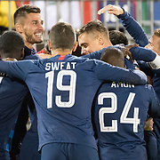 EAST HARTFORD, CONNECTICUT- October 16th: Josh Sargent #13 of the United States is mobbed by team mates after scoring during the United States Vs Peru International Friendly soccer match at Pratt & Whitney Stadium, Rentschler Field on October 16th 2018 in East Hartford, Connecticut. (Photo by Tim Clayton/Corbis via Getty Images)
