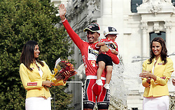 11.09.2011, Madrid,  ESP, LA VUELTA 2011, Finish, im Bild Juan Jose Cobo celebrates with his nephew the victory in La Vuelta 2011.September 11,2011. EXPA Pictures © 2011, PhotoCredit: EXPA/ Alterphoto/ Paola Otero +++++ ATTENTION - OUT OF SPAIN/(ESP) +++++