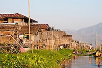 Fishing village with thatched houses on Inle Lake, Myanmar. Exotic places wall art. Fine art photography prints for sale. Stock Images.