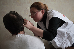 Dr Lydia Drishko examines a patient during a consultation at an MSF mobile clinic in the village of Sukodolsk near to Lugansk.