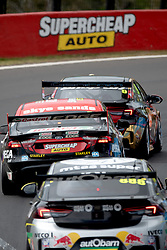 October 7, 2018 - Bathurst, NSW, U.S. - BATHURST, NSW - OCTOBER 07: David Reynolds / Luke Youlden in the Erebus Penrite Racing Holden Commodore leads Chaz Mostert / James Moffat in the Supercheap Auto Racing Ford Falcon and Race Winner Craig Lowndes / Steven Richards in the Autobarn Lowndes Racing Holden Commodore through the esses at the Supercheap Auto Bathurst 1000 V8 Supercar Race at Mount Panorama Circuit in Bathurst, Australia. (Photo by Speed Media/Icon Sportswire) (Credit Image: © Speed Media/Icon SMI via ZUMA Press)