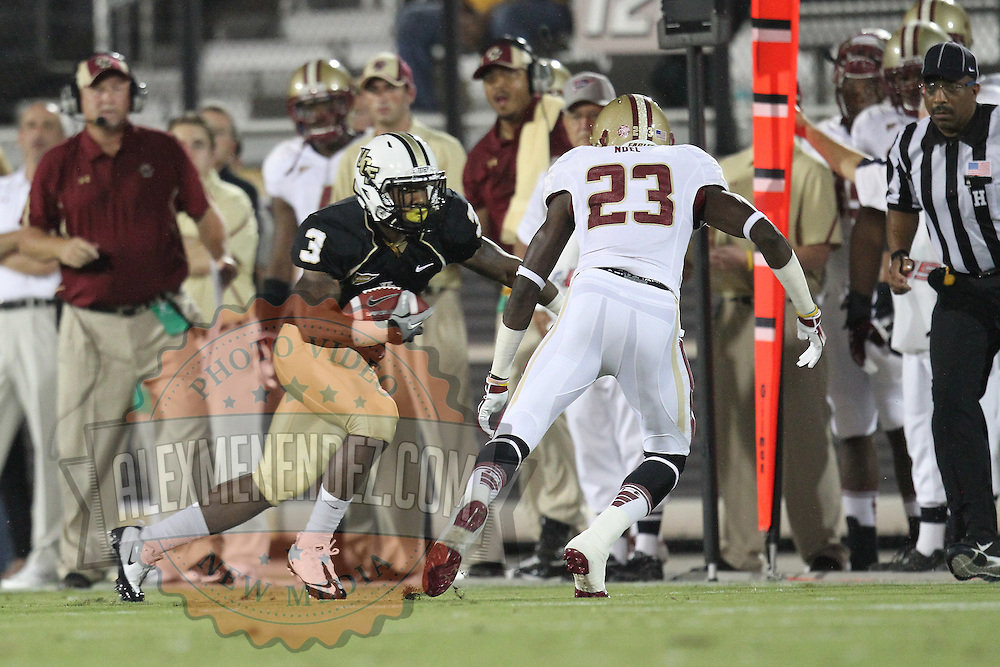 Boston College defensive back Jim Noel (23) tackles Central Florida wide receiver A.J. Guyton (3) during an NCAA football game between the Boston College Eagles and the UCF Knights at Bright House Networks Stadium on Saturday, September 10, 2011 in Orlando, Florida. (AP Photo/Alex Menendez)