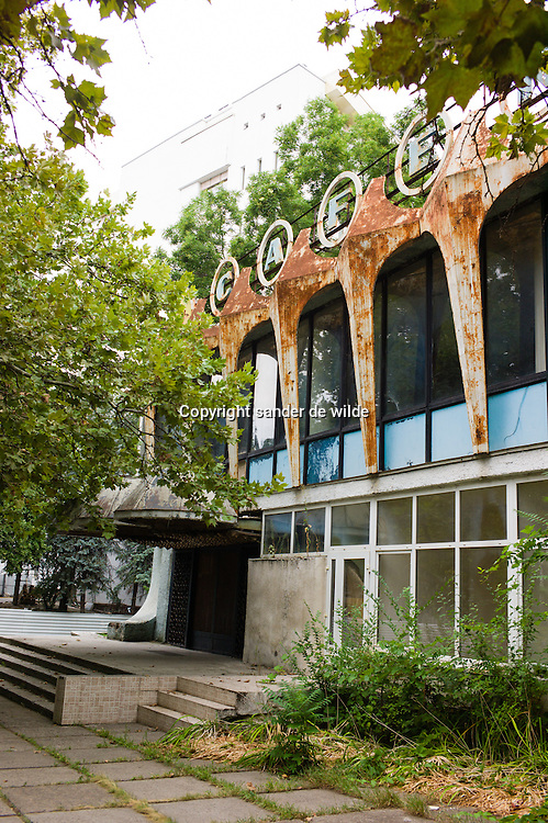 An abandoned and rusty cafy in a park in Chisinau, Moldova with fifites futuristic soviet design