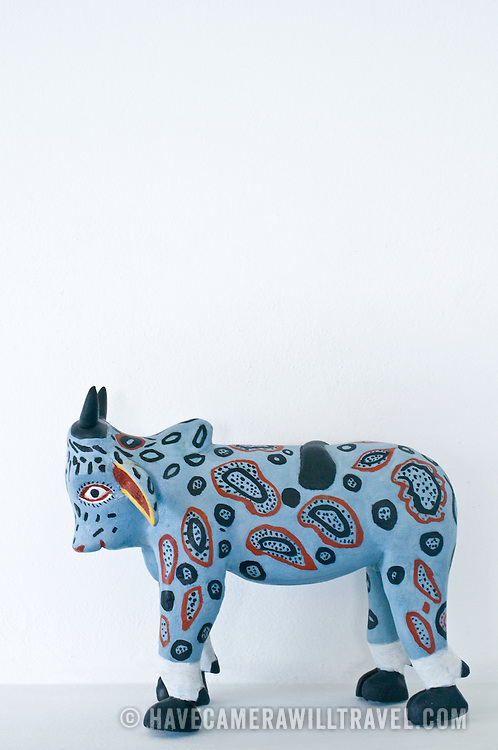 Local crafts of painted bull at Zihuatanejo, Mexico. (Note: this is not isolated on white--the shot was taken where the item is display, in a white room.)