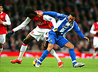 Photo: Tom Dulat/Sportsbeat Images.<br /> <br /> Arsenal v Wigan Athletic. The FA Barclays Premiership. 24/11/2007.<br /> <br /> Denny Landzaat of Wigan Athletic and Emmanuel Adebayor of Arsenal with the ball.